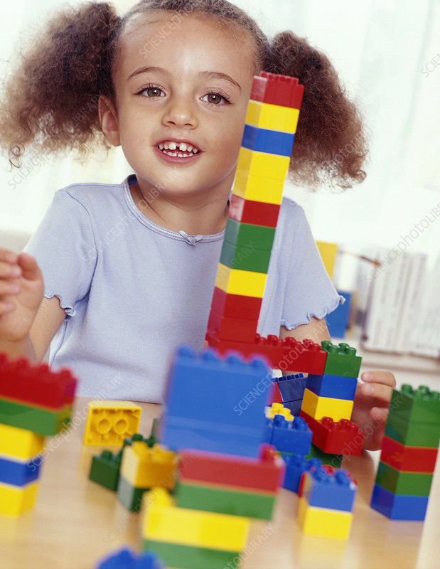 Girl playing with lego
