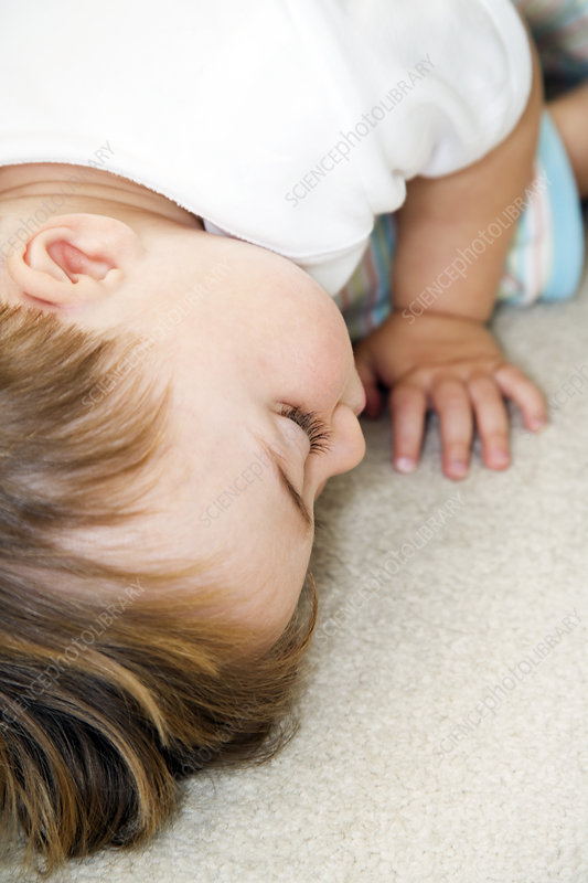 Toddler lying face down