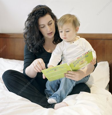 Pregnant mother reading to her child