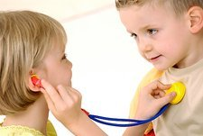 Children playing with a toy stethoscope