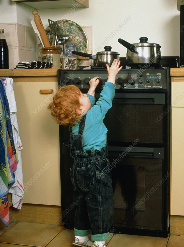 Child safety; child reaching for pan on cooker