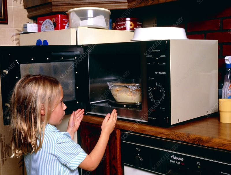 http://www.sciencephoto.com/image/294224/530wm/M8320029-Child_danger_young_girl_takes_food_from_microwave-SPL.jpg