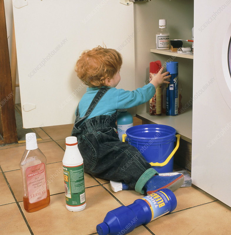 Child safety; child playing with bottles of bleach