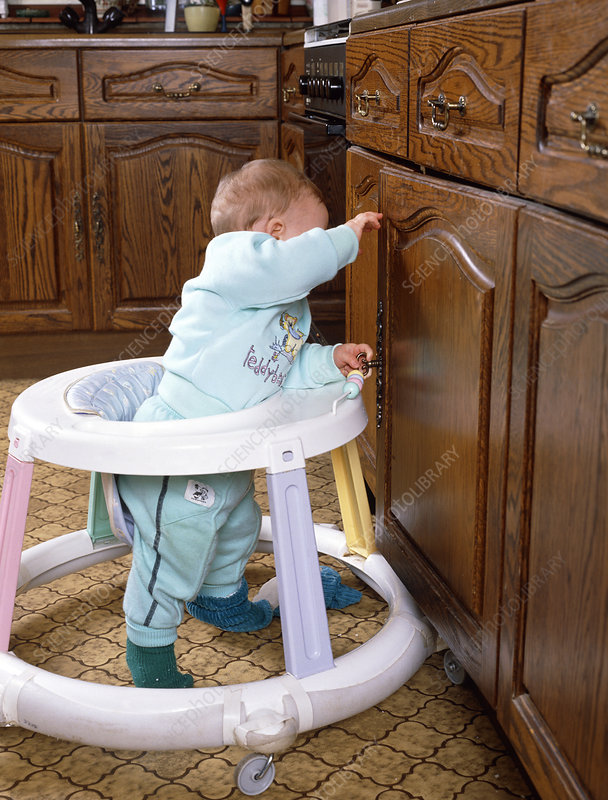Ten month old baby using a baby walker.
