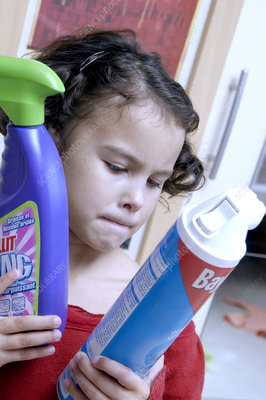 Young girl with cleaning products