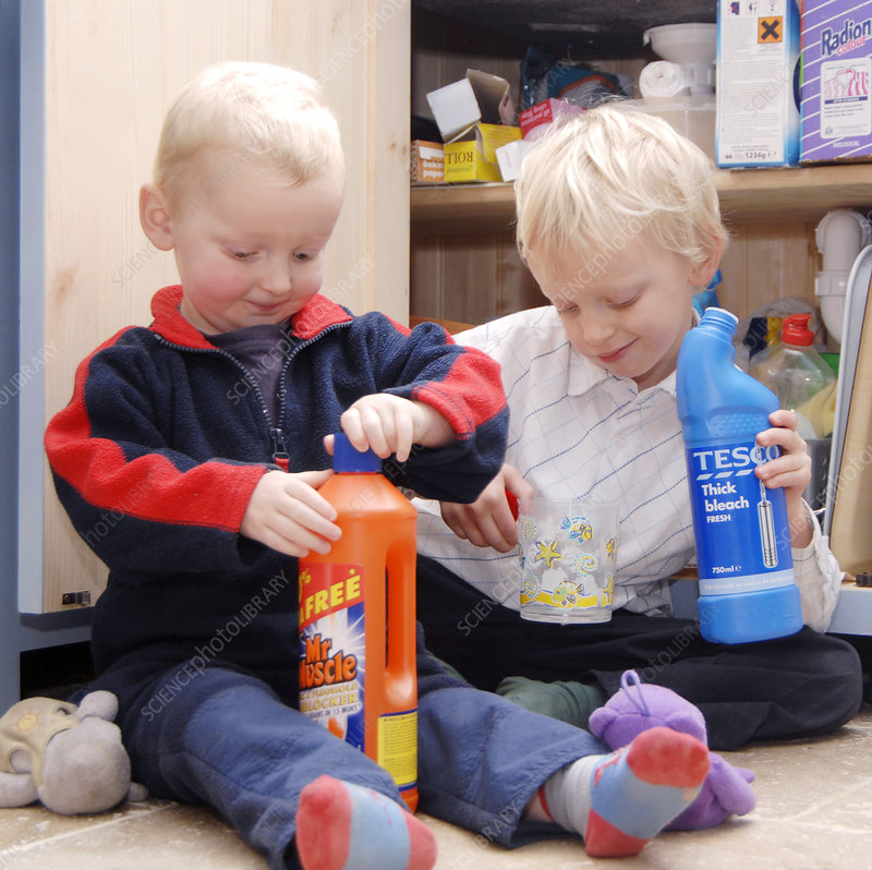 Children playing with cleaning products