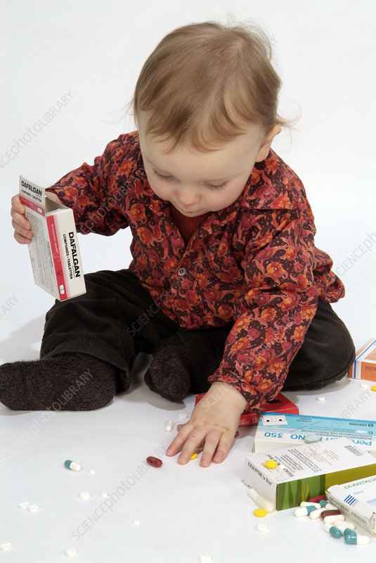 Toddler playing with pills