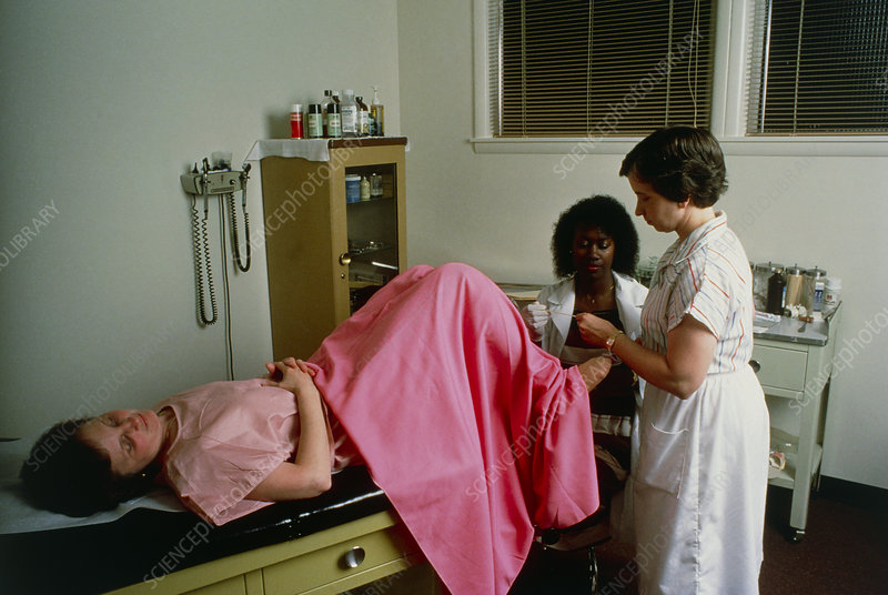 Doctor taking cervical smear