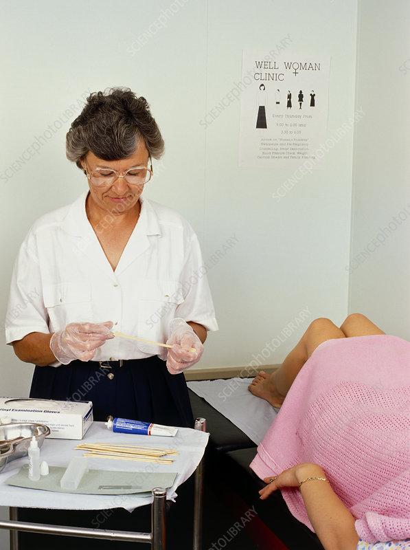 Nurse performing a cervical smear test