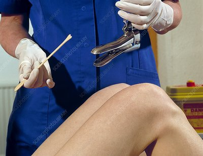 Nurse about to perform a cervical smear test