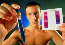 Man holding up a fertility colour-test