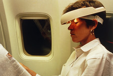 Woman wearing Jet Lag Visor during plane flight