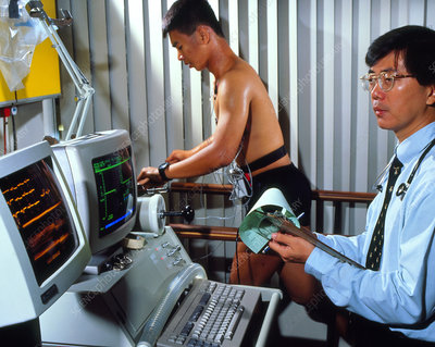 Man on treadmill with doctor and ECG machine