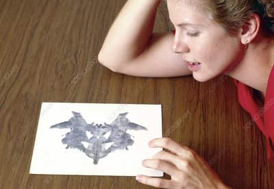 Woman taking Rorschach Ink Blot Test