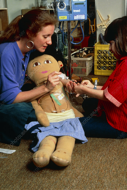 Child psychology: lessons with doll - Stock Image - M873