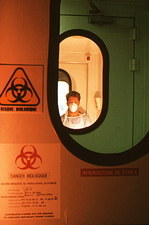 Dr Quentin Sattentau in air lock of an AIDS lab