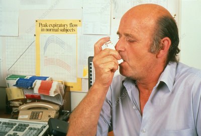 Asthmatic patient learning to use inhaler
