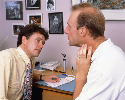 Doctor looking at lymph gland area of a man's neck