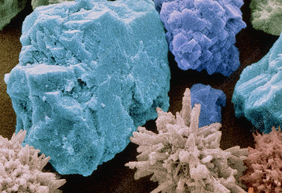 Coloured SEM of crystals of toothpaste abrasive.