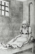 18th century female patient chained to a post