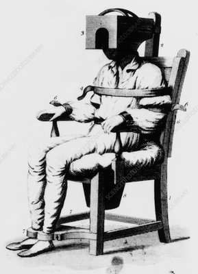 Mental patient strapped into a restraining chair