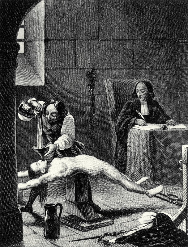 Engraving of a suspected witch being tortured