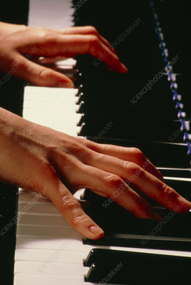 Playing the piano.