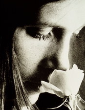 Woman smells a rose flower