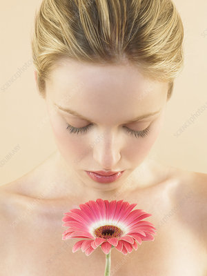 Woman smelling a flower