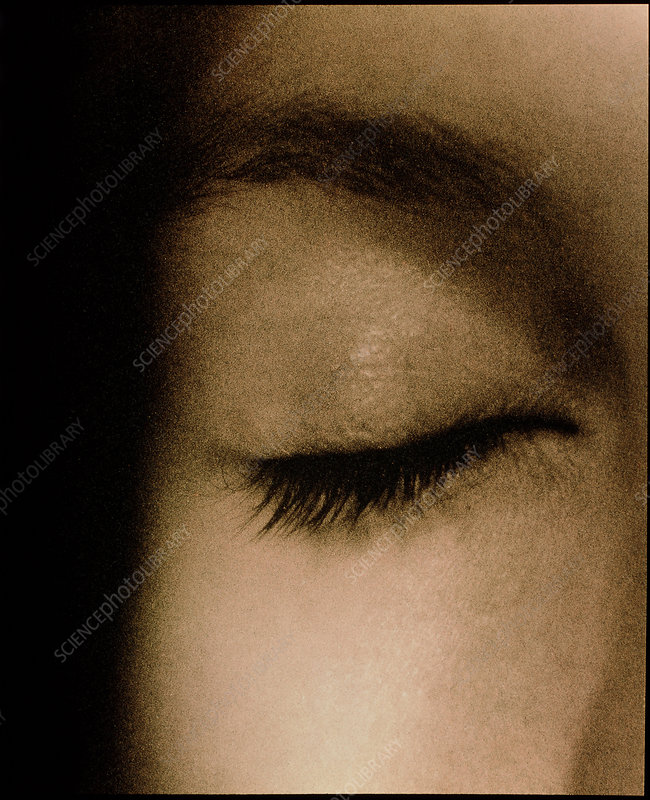 View of a woman's closed eye