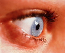 Close-up of a woman's healthy blue eye