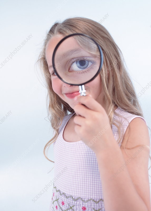 Eye through magnifying glass