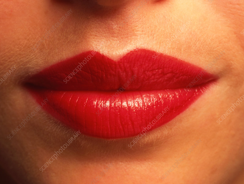 Close-up of the red lips of a woman (front view)