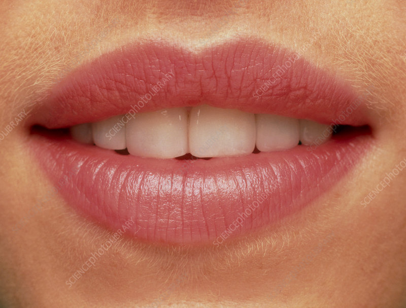 Close-up of a woman's mouth showing healthy teeth