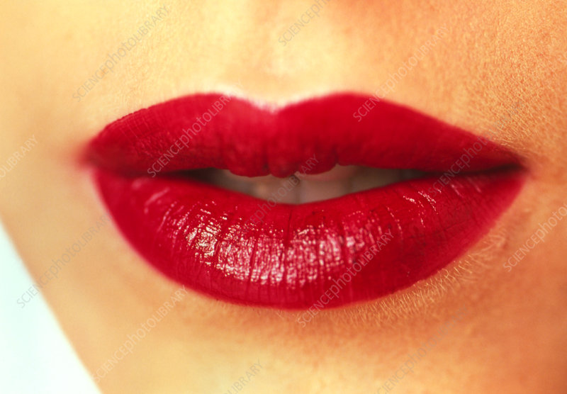 Close-up of the mouth of a woman wearing lipstick