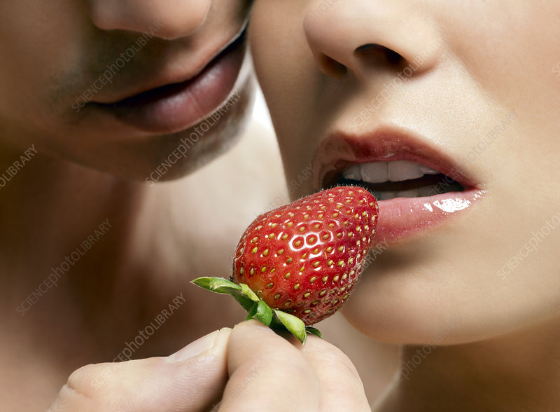 Lovers eating strawberries