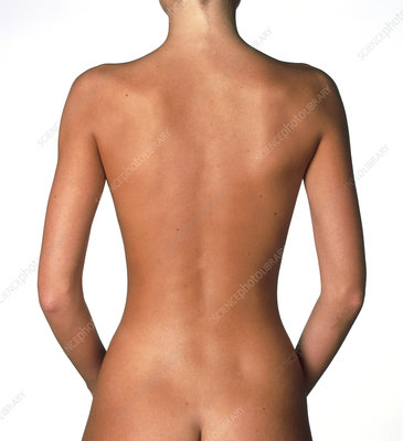 View of a standing woman's naked back
