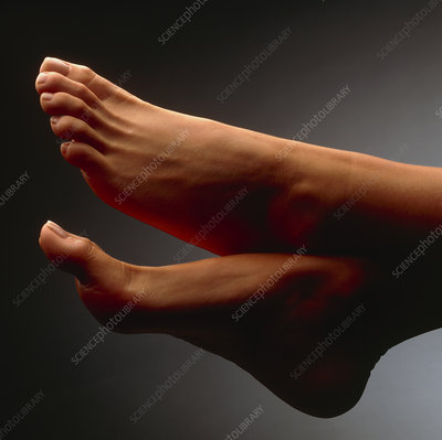 Side view of the healthy feet of a woman