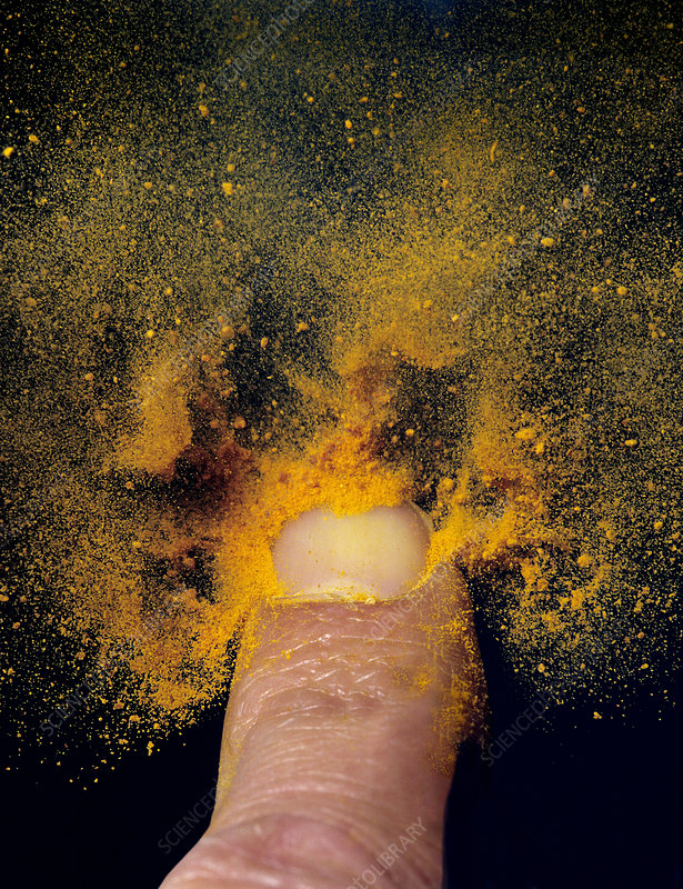 Powder blown from a fingernail