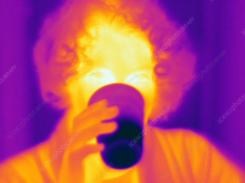 A thermogram of a woman with a cool drink
