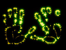 Kirlian photograph of the palms of a woman's hands
