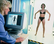 Computer measuring woman's body for fashion design