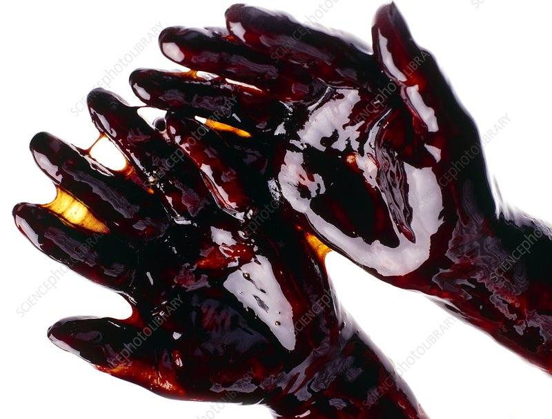 Woman's hands coated in syrup