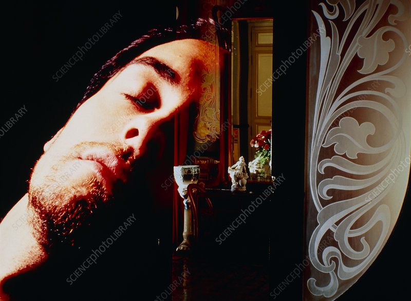 Abstract image of man dreaming while asleep