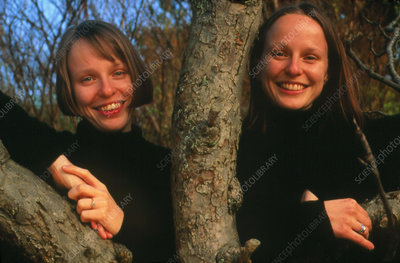 Portrait of identical twins in adolescence