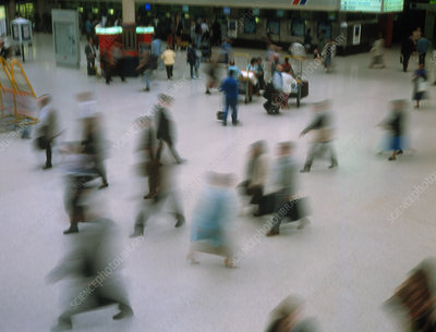 Time exposure image of train station commuters