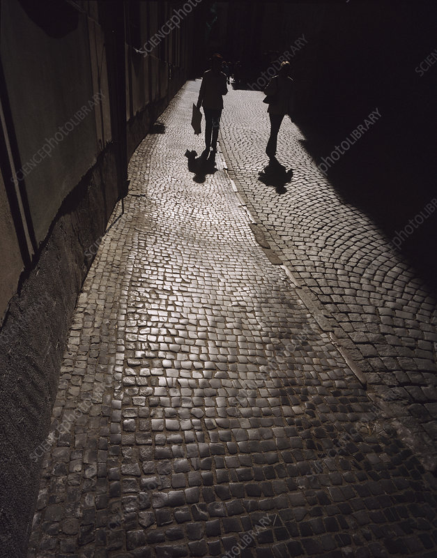 People walking on cobbles