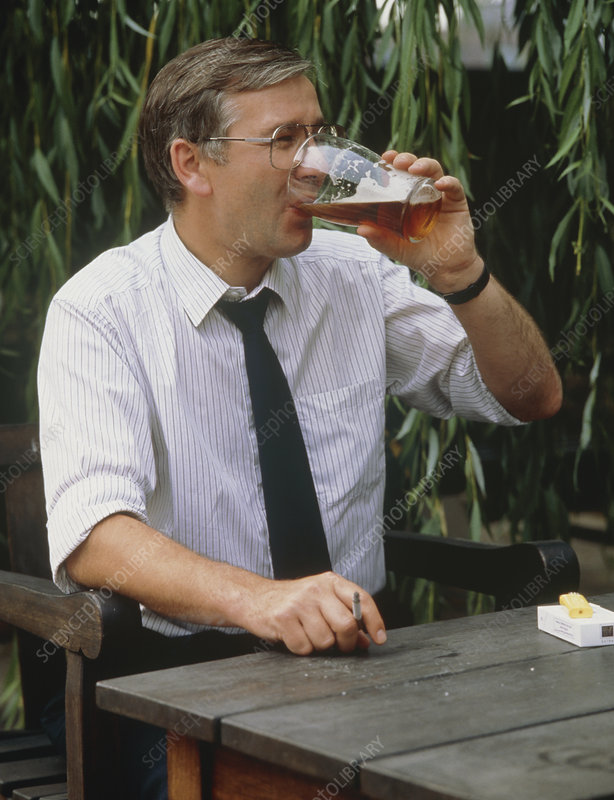 Man drinking a pint of beer.