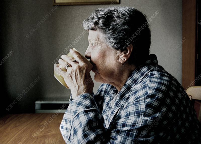 Elderly woman drinking