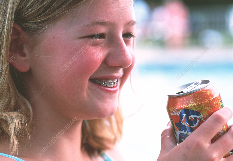 Young girl drinking soft drink